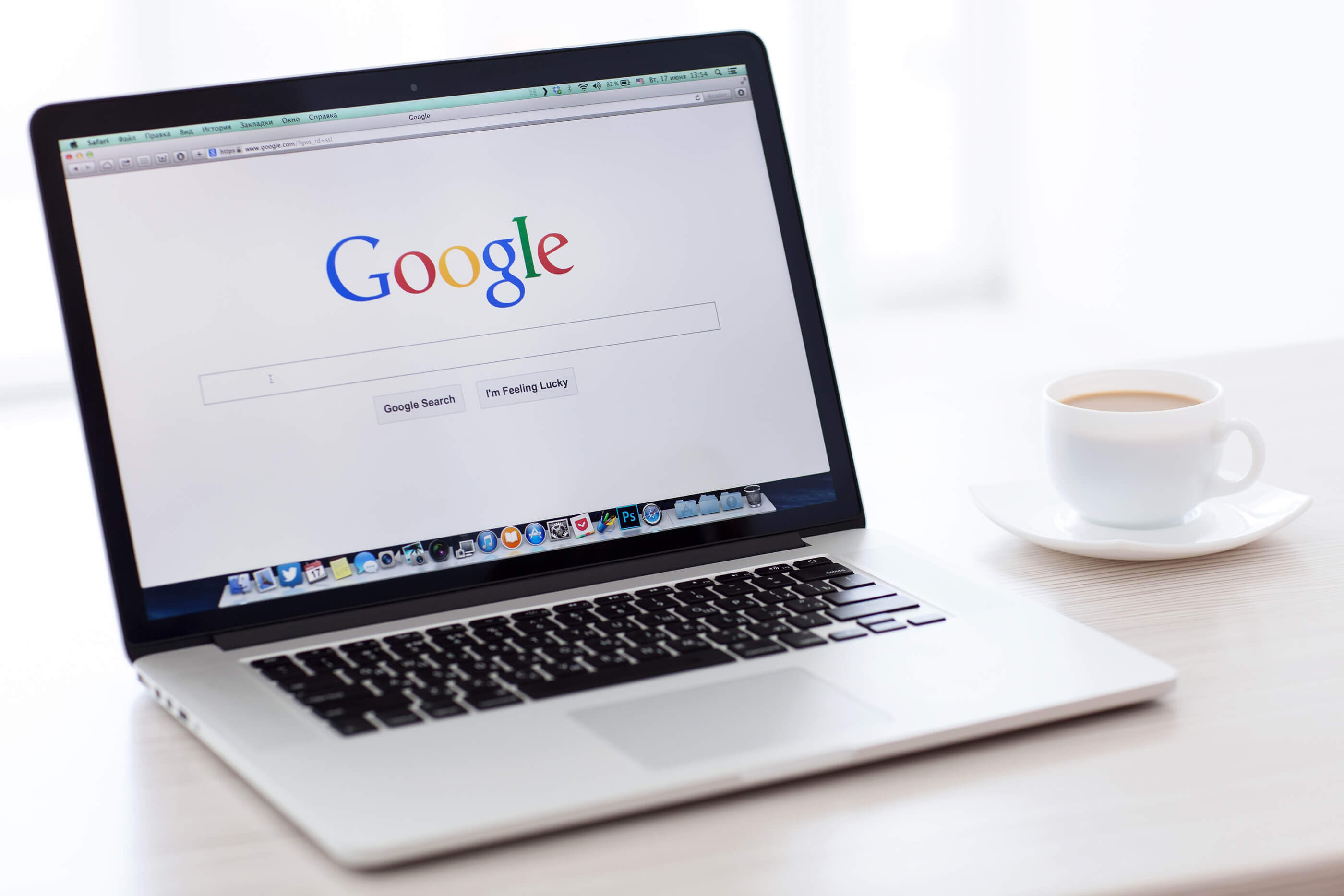 Image showing Macbook Pro Retina With Google Home Page On The Screen Stands On