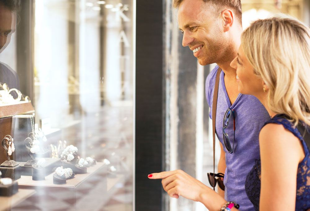 Image showing Couple looking at jewelry store window