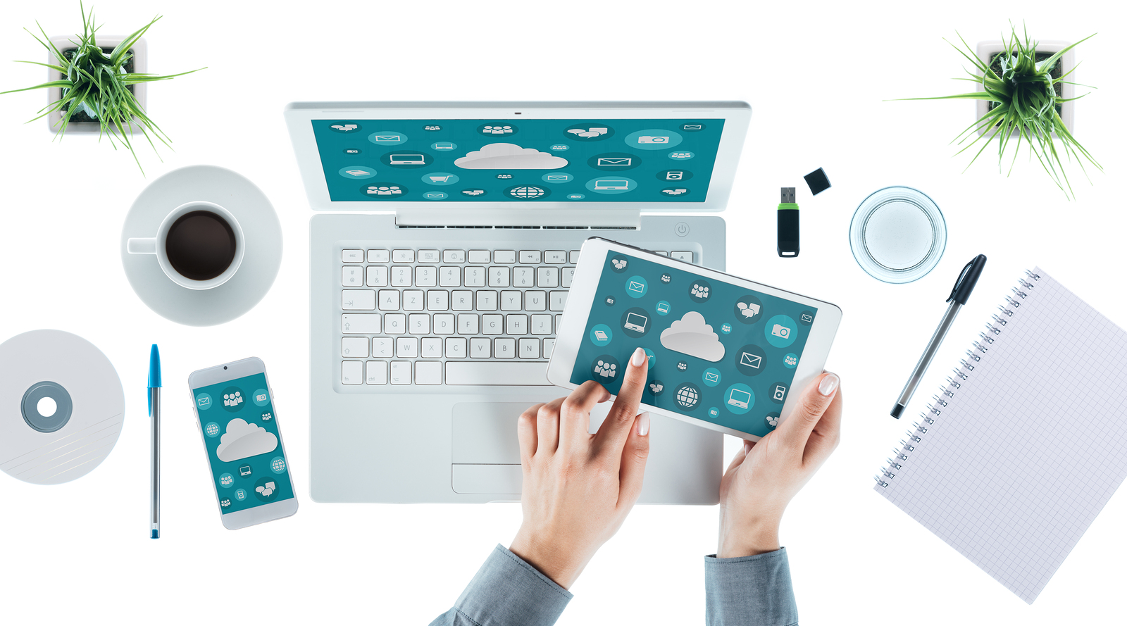 Cloud computing and multiplatform concept user interface on laptop tablet and smartphone female hands touching an icon